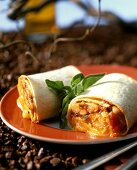 Rolled tortillas with scrambled egg and tomato and bean salsa