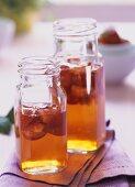 Home-made strawberry vinegar in two bottles