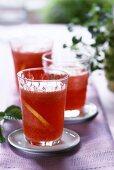 Strawberry lemonade with lemon slices in glasses