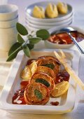 Pork medallions with sage in tomato sauce
