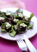 Beetroot with parsley butter on beetroot leaves
