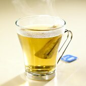 Hot chamomile tea with tea bag in glass