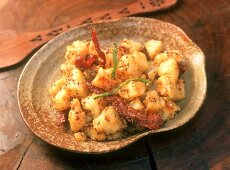Alu achar (potatoes with sesame and chili), Kashmir