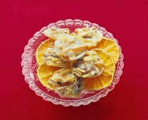 Date and orange biscuits on dried orange slices