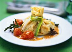 Asparagus in herb pancake with braised tomatoes