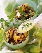 Shiitake mushroom pilaw with turmeric kefir sauce on spoon
