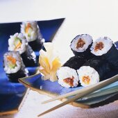 Hosomaki sushi with pumpkin and with carrot and cucumber