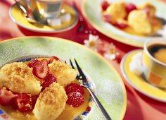 Semolina dumplings with strawberries and mango sauce