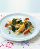 Avocado salad with carrots and pink grapefruit
