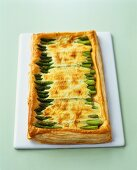 Green asparagus and cheese in puff pastry tart