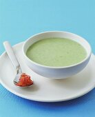 Cold avocado soup with diced tomato