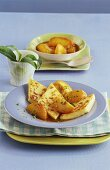 Semolina slices with peach compote and chopped pistachios