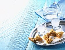Diples (deep-fried Greek pastry bows) and ouzo