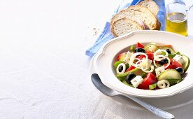 Greek peasant's salad, white bread and olive oil
