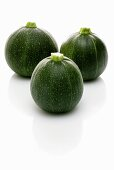 Three round courgettes