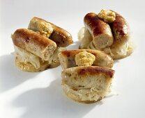 Nuremberg sausages on sauerkraut and potato slices