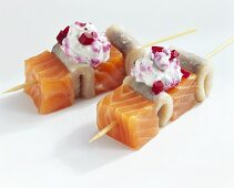 Salmon and matjes herring on two cocktail sticks