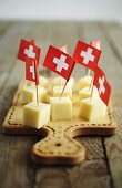 Diced cheese with Swiss flags on chopping board