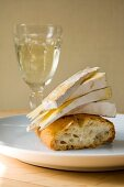 Brie with white bread and white wine