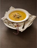 Sweet potato soup with sesame and toasted coconut shavings