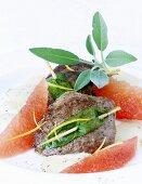 Venison escalopes with sage and grapefruit