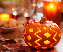 Halloween: pumpkin with carved pattern
