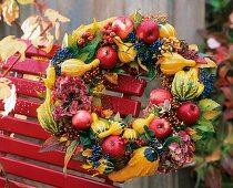 Wreath of pumpkins, apples, Guelder rose berries, hydrangeas