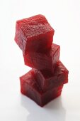 Four cubes of beetroot, stacked