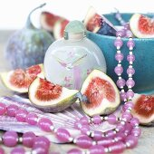 Figs, cosmetic product and string of beads