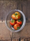 Four tomatoes, variety 'Red Zebra'