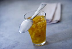 Pineapple jam in a glass with spoon