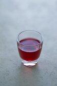 A glass of cassis liqueur