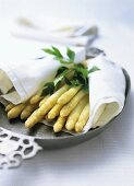Cooked asparagus with parsley on a cloth