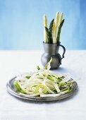 Green and white asparagus, peeled with peelings