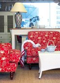 Floral upholstered chairs, wicker table