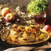 Chicken with oven-baked potato and apple