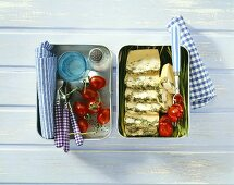 Frittata with goat's cheese and tomatoes in a lunch box