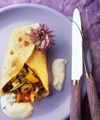 Crepe with olive filling and yoghurt sauce