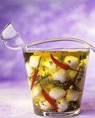 Mozzarella and chillies in olive oil