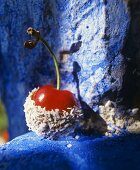 Cherry dipped in chocolate and grated coconut