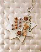 Christmas sweets & Muskatzinen (spicy biscuits) on star-shaped tray