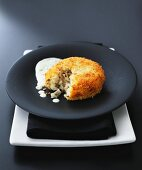 Fish cake with parsley sauce