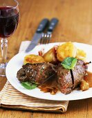 Beef roulade with shallot sauce and fried dumpling slices