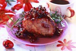 Roast pork glazed with cranberry jam
