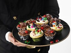 A chimney sweep serving chocolate & banana muffins for New Year's Eve