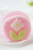 Pink jelly sweet with sugar flower