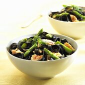 Squid ink pasta with salmon and green asparagus