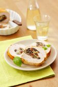 Turkey roulade stuffed with mozzarella, olives and dried tomatoes