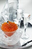 Salmon caviar and two glasses of vodka