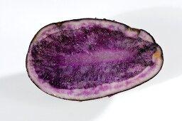 Half a blue potato (variety 'Blue Salad Potato')